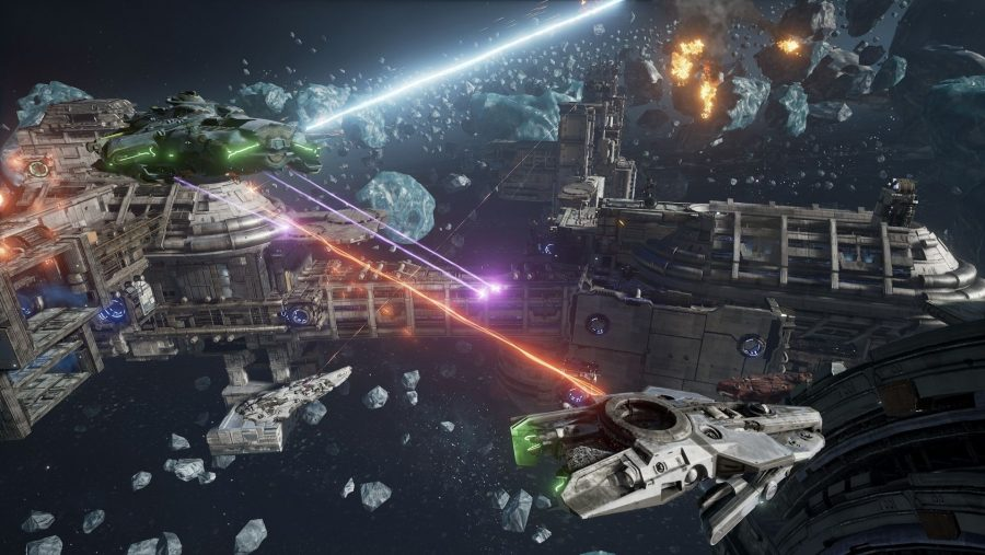 Lasers shoot across an asteroid field in one of the best free PC games, Dreadnought