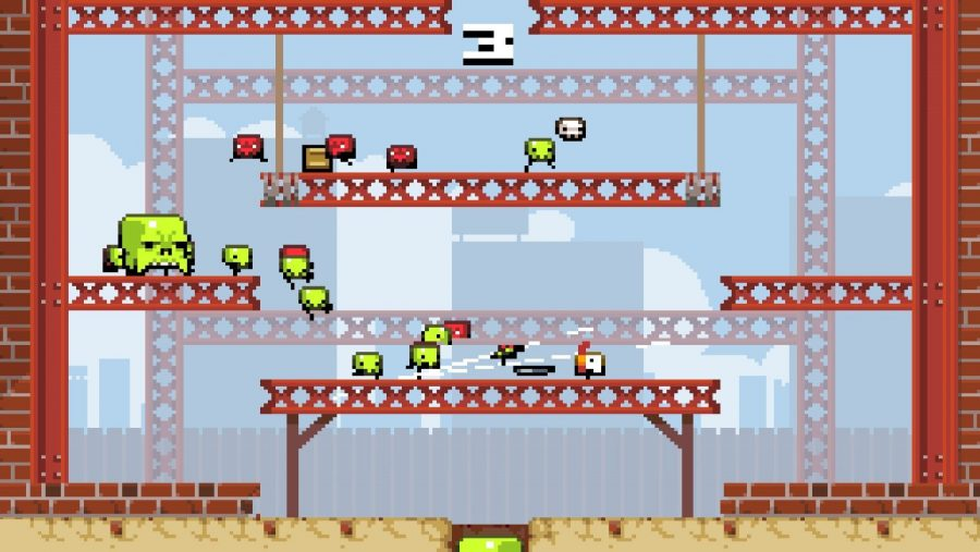 Several green and red skull enemies littered dangerously across the screen in one of the best free PC games, Super Crate Box 2